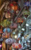 Traditional Vintage Turkish Lamp. Traditional bright decorative hanging Turkish lamps and colourful lights with vivid colours  in the Istanbul Bazaar, Turkey Royalty Free Stock Photography