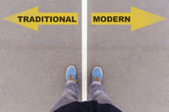 Traditional vs modern text arrows on asphalt ground, feet and sh Stock Images