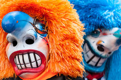Traditional Waggis Masks At Fasnacht Festival Basel, Switzerland. Two traditional waggis masks with orange and blue hair at fasnacht festival Basel, Switzerland royalty free stock photo