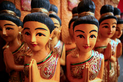 Traditional wai greeting, Thailand. Wooden statues performing traditional Thai wai greeting Stock Photo