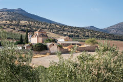 Traditional walled courtyard around farm or hotel in Spain. Walled courtyard around church in boutique hotel Cortijo del Marques with hills in distance near royalty free stock photography