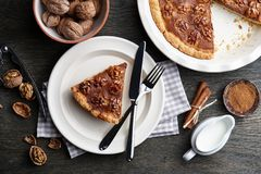 Traditional walnut pie with spices and nuts on dark wooden table. Top view stock photos