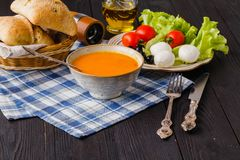 Traditional warming pumpkin soup, homemade with bread and antipasti royalty free stock photo