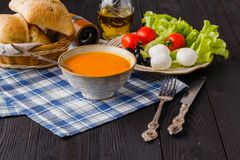 Traditional warming pumpkin soup, homemade with bread and antipasti royalty free stock photos