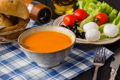 Traditional warming pumpkin soup, homemade with bread and antipasti stock image