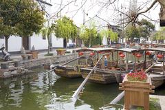 Traditional water taxi's in the canal, Zhujiajiao, China. Traditional water taxi's in the canal. Many wooden boats are docked together with Chinese lanterns royalty free stock photography