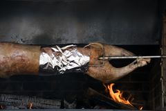 Traditional way of cooking a whole animal - roasting an over low heat. Traditional way of cooking a whole animal stock images