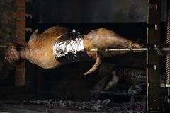 Traditional way of cooking a whole animal - roasting an over low heat. Traditional way of cooking a whole animal stock image