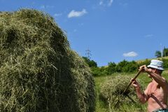 Traditional way of hay stocked in the village Royalty Free Stock Photography