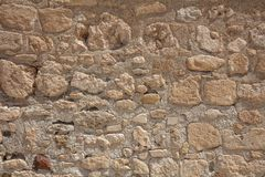 Traditional weathered stone wall background in Cyprus. Traditional weathered sand stone wall background in Cyprus royalty free stock images