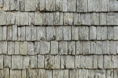 Traditional weathered wooden shingles close up texture. stock photo