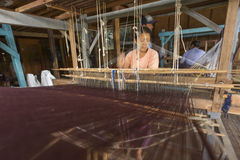 Traditional Weaving. While I traveling in Inle, Myanmar. I found rare traditional waving method here Royalty Free Stock Photo