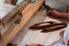 Traditional weaving loom. Woman sitting at traditional weaving loom Stock Photos