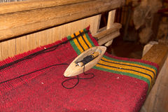 Traditional weaving and a shuttle on machine Stock Photography