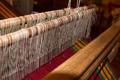 Traditional weaving and a shuttle on machine Stock Photos