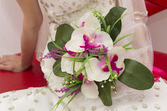 Traditional wedding bride close up hands holding flowers Stock Image