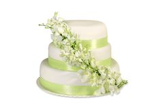 Traditional wedding cake with orchid flowers Royalty Free Stock Images