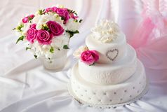Traditional wedding cake with rose flowers Royalty Free Stock Photo