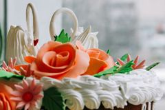 Traditional wedding cake. The upper part of the traditional wedding cake with figures of two swans Stock Photo