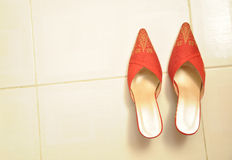 Traditional wedding shoes. Among the Malays, when bersanding ceremony, both the bride and groom will wear baju Melayu and the bride will wear baju kurung Royalty Free Stock Photography