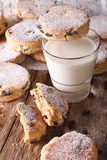 Traditional Welsh cakes with raisins and milk close-up. vertical Royalty Free Stock Photos