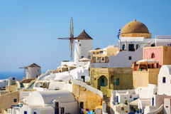 Traditional white architecture with blue churches on Santorini island, Greece Stock Photos