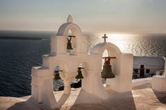 Traditional white bell tower at Oia Stock Photo