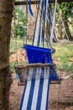 Traditional white and blue cloth for clothing being handwoven outside in Ivory Coast, West Africa Stock Images