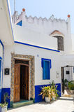 Traditional white and blue washed houses in side alley of historical Moroccan town Asilah, Morocco, North Africa Royalty Free Stock Images