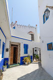 Traditional white and blue washed houses in side alley of historical Moroccan town Asilah, Morocco, North Africa Stock Photography