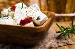 Traditional white cheese slices. In oil with spices. Selective focus Royalty Free Stock Images