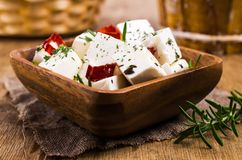 Traditional white cheese slices. In oil with spices. Selective focus Stock Photo