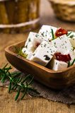 Traditional white cheese slices. In oil with spices. Selective focus Stock Image