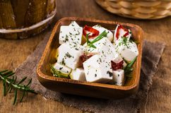 Traditional white cheese slices. In oil with spices. Selective focus Royalty Free Stock Photo