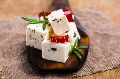 Traditional white cheese slices. In oil with spices. Selective focus Royalty Free Stock Photography