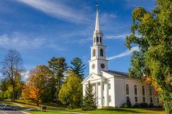 Traditional White Church and Blue Sky in Autumn Stock Images