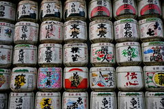 Traditional white and colorful cylinders with sign letters in Japanese language in Japanese temples Royalty Free Stock Photography