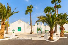 Traditional white houses and palm trees Royalty Free Stock Photography
