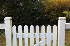 Wooden picket fence gate in white Royalty Free Stock Photography