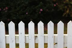 Wooden picket fence in white. Traditional white picket fence in white Stock Photos