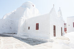 Traditional white-washed Greek houses. On the island of Mikonos symbolic of a tropical summer vacation stock image