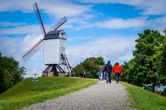 Traditional white windmill at the historical Bruges town stock images