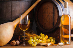 Traditional white wine and barrels Royalty Free Stock Photography