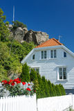 Traditional white wooden house in Norway Royalty Free Stock Photos