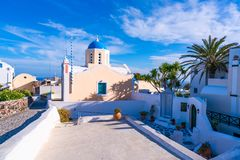 Traditional whitewashed house and church with blue dome in Oia. Santorini. Santorini landscape with traditional whitewashed houses and church with blue dome in royalty free stock images