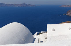 Traditional whitewashed house in Fira town. Traditional whitewashed Cycladic house in Fira town on Santorini Stock Image