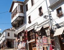 Traditional Whitewashed Stucco Buildings with Souvenir Shops in Old Town Gjirokaster Albania