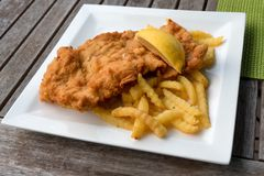 Traditional Wiener schnitzel. Dinner plate of traditional Austrian dish Wiener schnitzel. It is a very thin, breaded and deep fried schnitzel made from veal Stock Image
