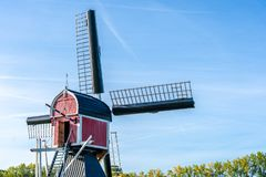 Traditional wind mill in a rural landscape royalty free stock photography