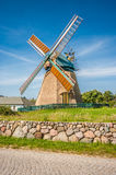 Traditional windmill with blue sky and clouds Royalty Free Stock Photos